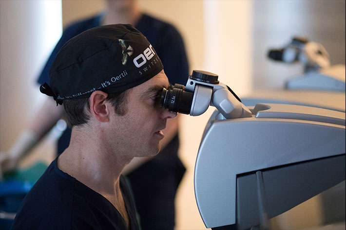 woman assisting with laser eye surgery