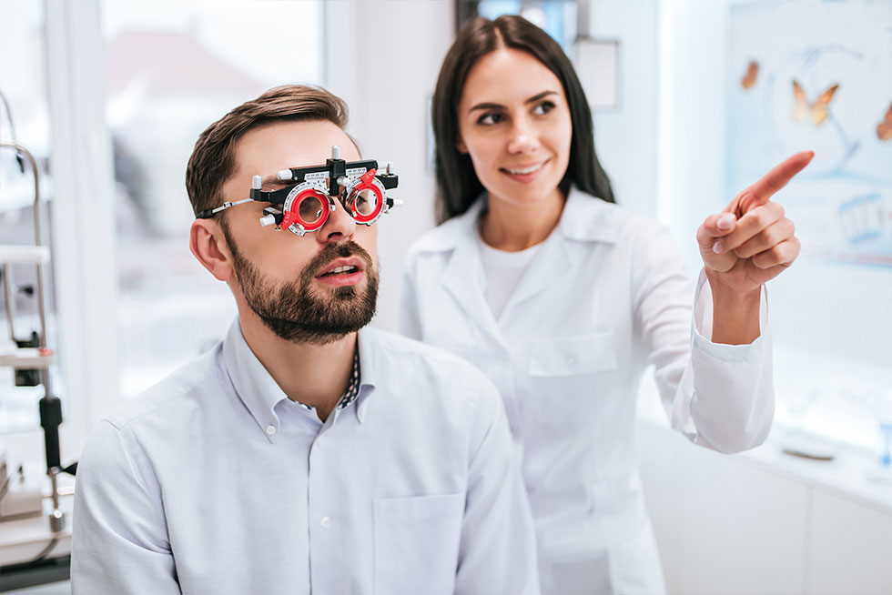 Eye specialist asking questions during eye test